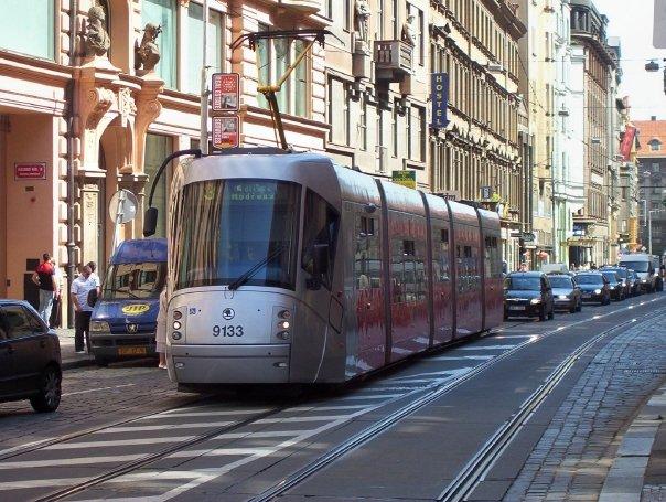 notice cars stuck behind light rail train in Prague